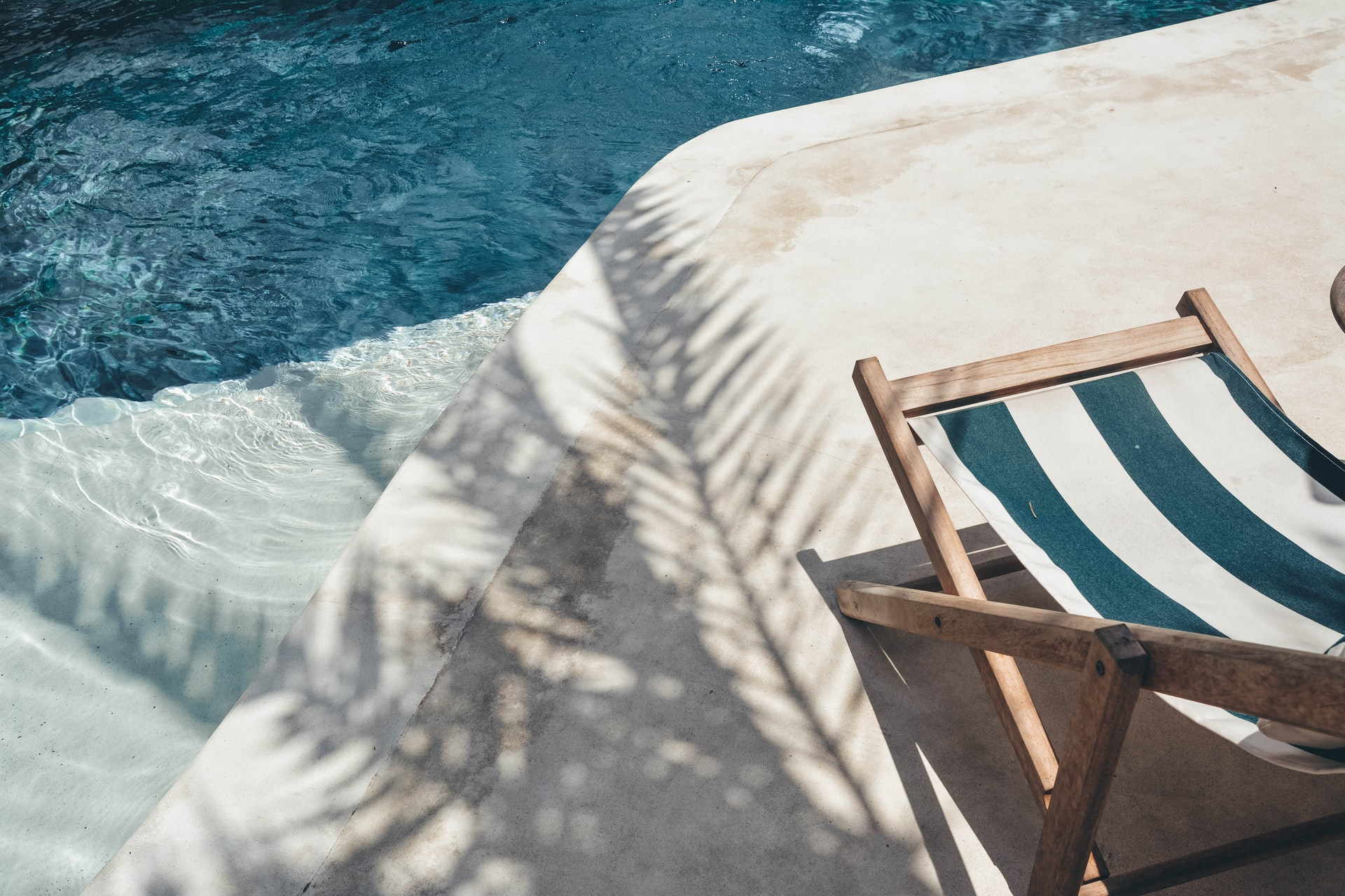Salt water pool image with a beach chair