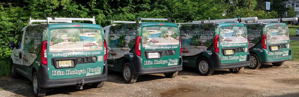Four Rin Robyn service vans lined up for the mornings work