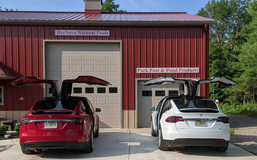 Image showing two Tesla Model X's in front of one of the BioNova warehouses