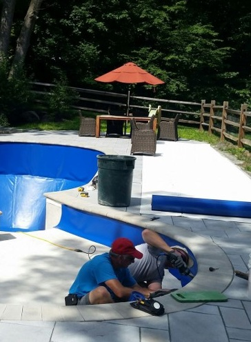Our installers working on a very custom shaped pool