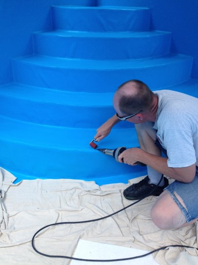 Eric heat welding PoolHide® to a step of pool steps