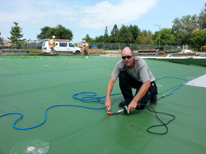 Eric heat welding PoolHide® at Webber Natural Swimming Pool