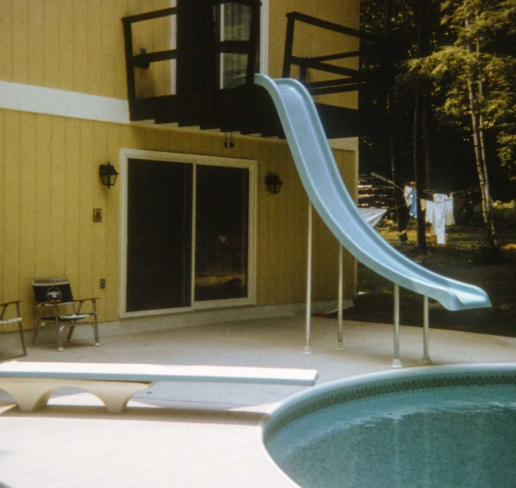 50 years ago, this homeowner wanted a slide from their bedroom in order to enjoy a morning wakeup swim.