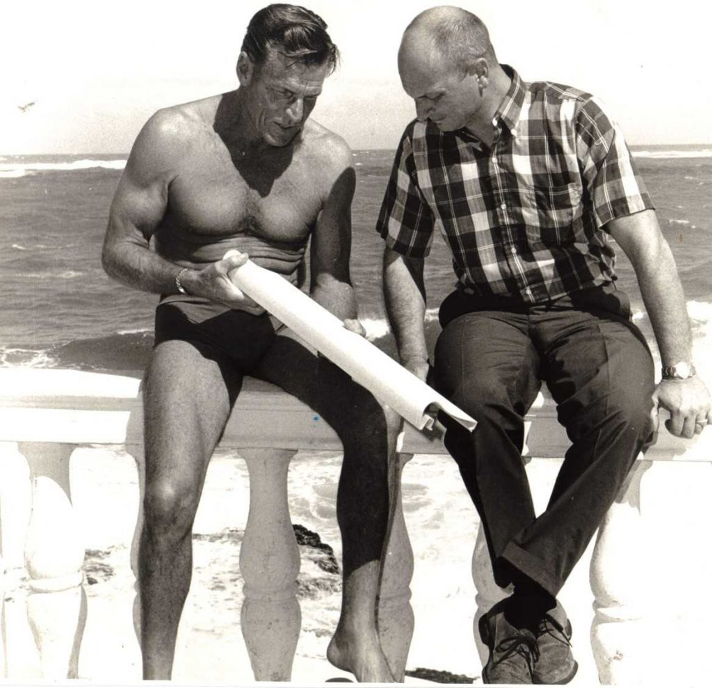 Buster Crabbe and Rin Robyn in Nassau, 1962. Rin Robyn is the person wearing clothes.